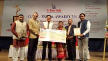 Union Minister of State for Home Kiren Rijiju hands over O.N.E. India award – 2014 to Patricia Mukhim, Editor, The Shillong Times in Mumbai on Monday.